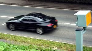 Picture of car driving past a speed camera