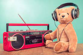 Picture shows a teddy bear listening to the radio